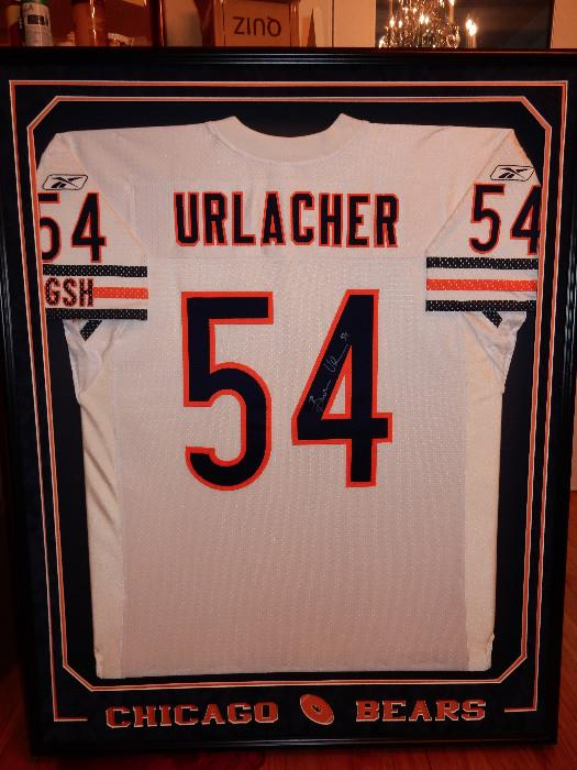 Signed Urlacher Jersey in a Beautiful Double Matted Frame.