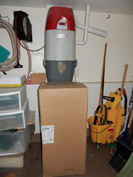 Brand New, unused NuTone central vac in box. Same unit as the one hanging on wall.