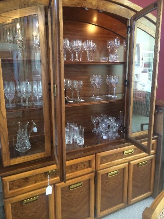 Large china cabinet has matching dining table and server.