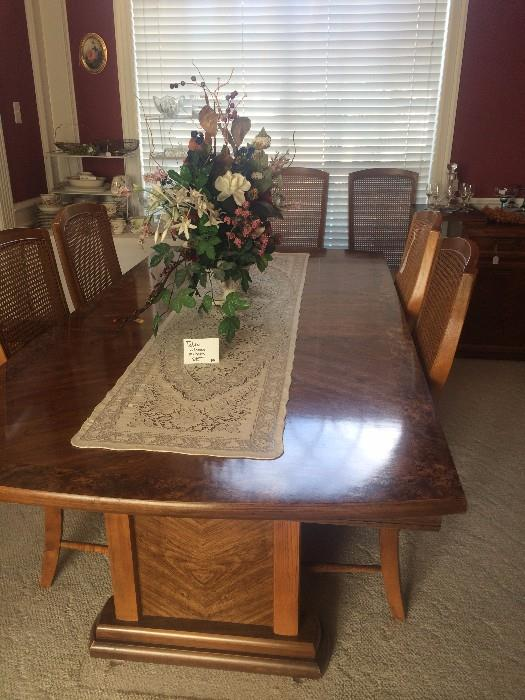 Large dining table has matching chairs, server, & china cabinet .