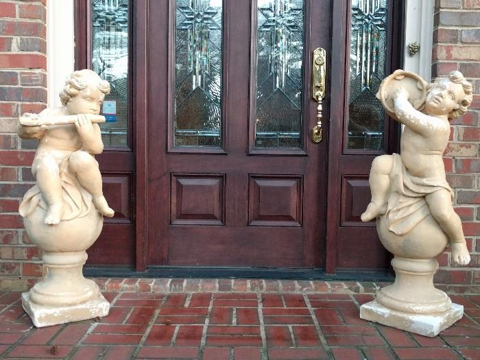Welcoming musical concrete putti - these things are heavy!                                                                                    Too much figgy pudding over the holidays...