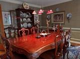 Dining room, featuring Spanish hand carved mahogany table & 8 matching chairs.