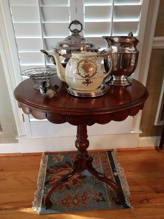 Cute, little round mahogany table, silver plated serving pieces, Japanese teapot, Goebel bird, silver overlay bowl, all sitting on it's own mini-Persian ruglet.