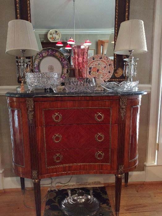 French commode (it doesn't flush) with marble top & bronze mounts, pair of drippy glass table lamps, cranberry cut to clear vase, American Brilliant ferner and low bowl.