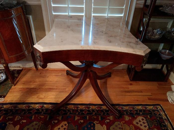 This is a convertible 1940's mahogany table. Huh, you ask? It has a tooled leather top, under a custom made marble top.                                                                         Umm Hmm, fancy!