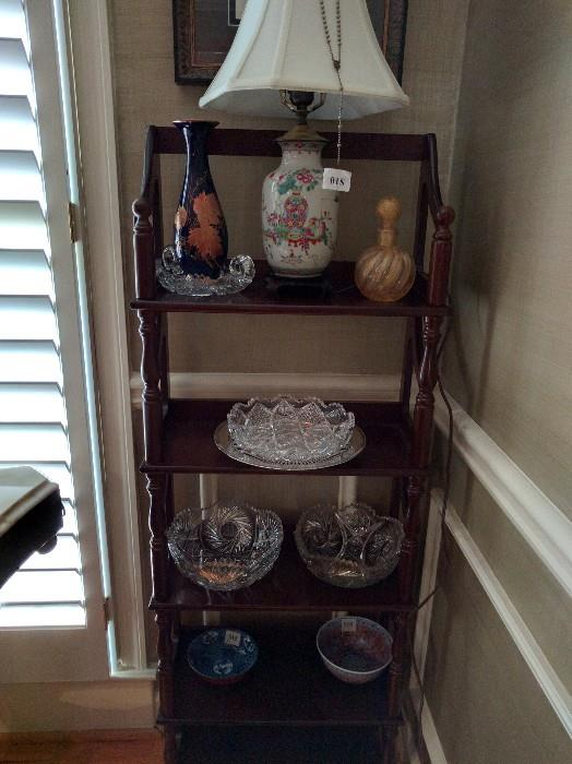 """Cheap mahogany etegere, with nice Asian lamp, Murano glass swirly gold perfume bottle, ABCG low bowl, two 8"""" diameter ABCG bowls, two small Asian bowls."""
