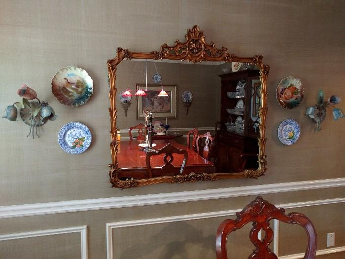 Large Italian Gold, hand carved wooden mirror, pair of English hand painted plates, pair of blue & white Italian plates, custom made metal sconces, with tulips and grasshoppers - yep, grasshoppers. You won't see another pair of these.