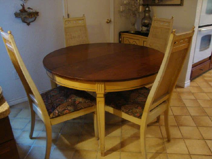 Table with leaf and four Chairs