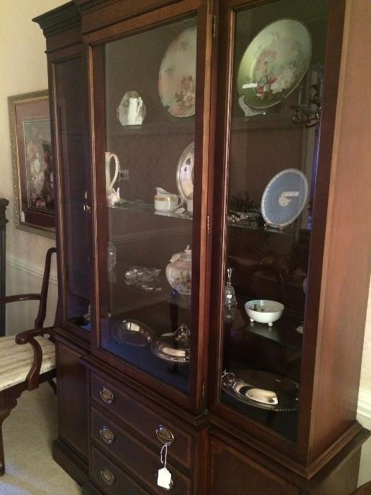 Four- shelf china cabinet with below storage