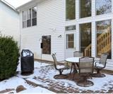 BBQ pit, Outdoor table with four pedestal chairs