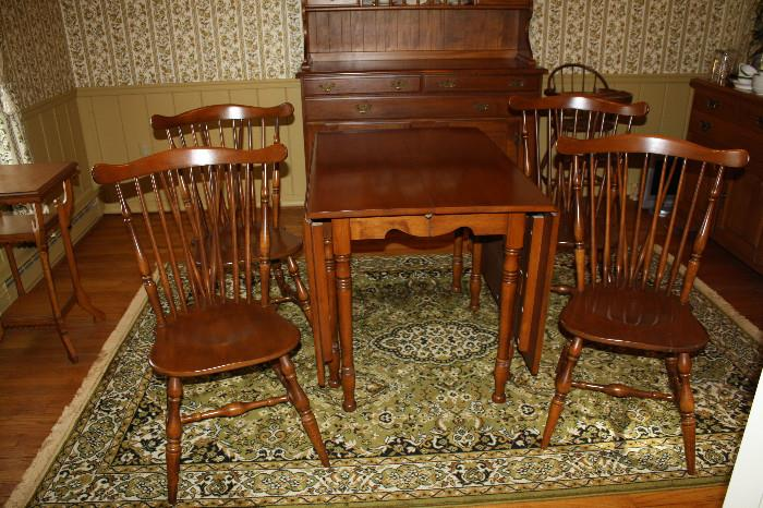 Maple drop leaf table with extension and table pads and 4 matching chairs