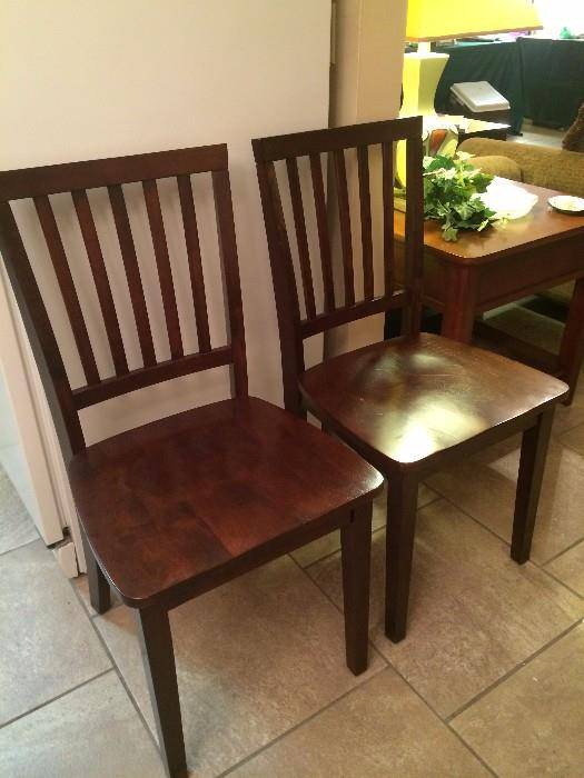 Two of four identical chairs