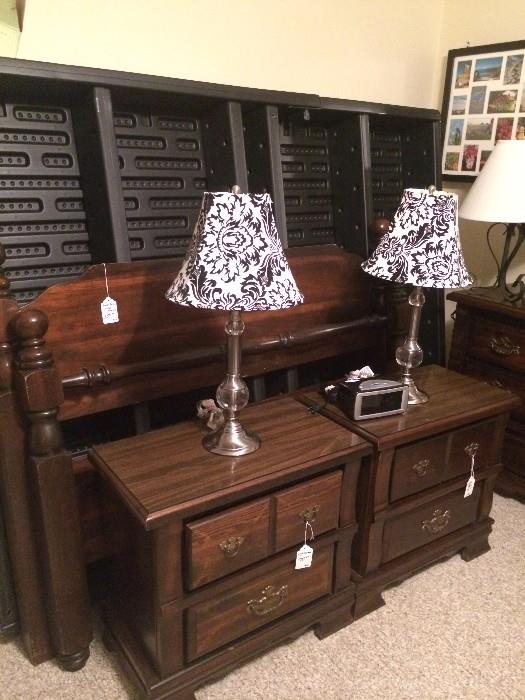Queen air bed has head board and foot board with matching nightstands, dresser, and chest.