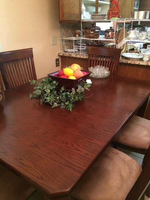Dining table (with leaves) has 6 chairs.