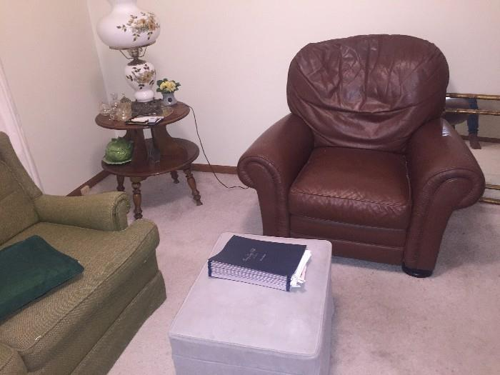 LEATHER CHAIR, OTTOMAN AND TWO-TIER TABLE