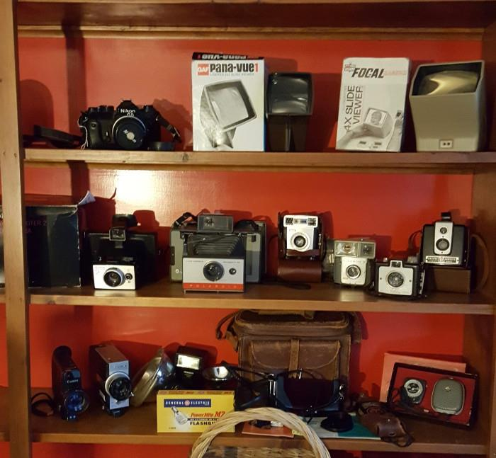 Nikon FE with 50mm lens; slide viewers; Poloroid Land Cameras; Kodak Brownies; movie cameras; light meters