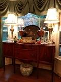 1940's mahogany sideboard, pair of very heavy brass lamps (I know they're good, just cannot find a maker's mark) large, English handpainted wooden tray, pair of decorative urns, Galle bowl and vase, collection of cut glass baskets, Asian porcelain fishbowl.                   Great Aunt Hulga was into fish...                                               I don't know which mortuary the swag window treatments were stolen from, but feel free to purchase them.