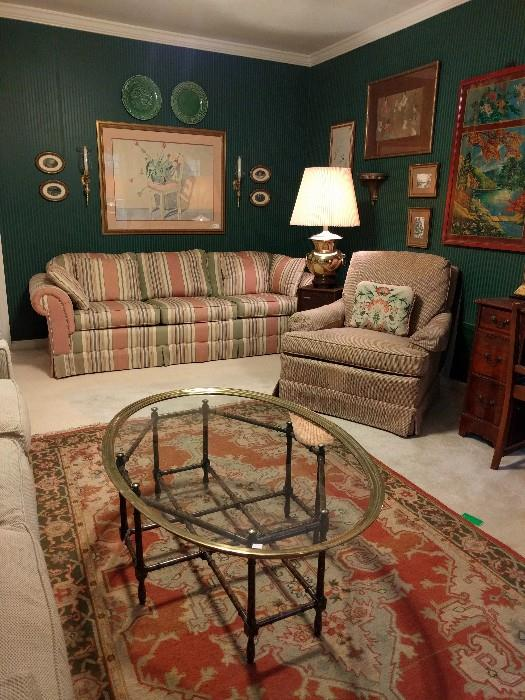 Horrible 1980's striped sofa, but in pristine condition, pair of majolica plates, 4 small, oval hand needlepointed pieces. This woman was a real homemaker. She was a doll/dollhouse fanatic, gardener, needlepointed, seamstress, etc.