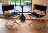 Chrome and nagahide 60's director's chairs . Smokey glass vase also vintage 60's