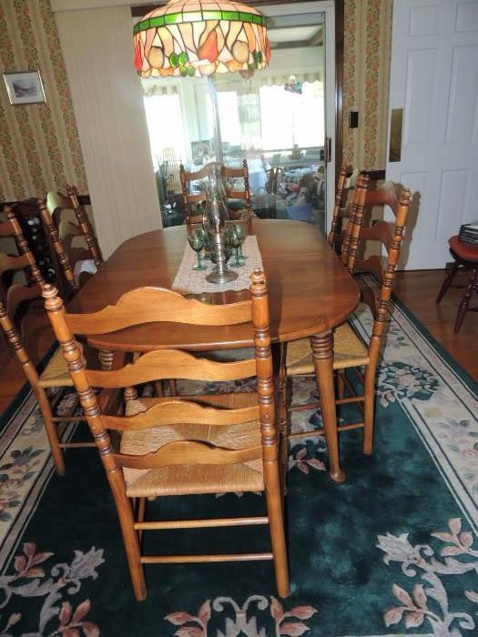 Thomasville oval table with one leaf, 4 ladder-back chairs, 2 ladder-back arm chairs, wool rug