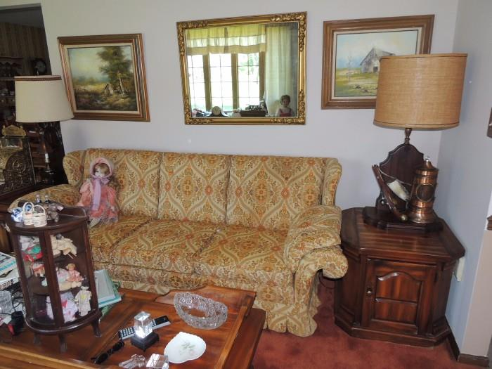 Sofa with matching love seat, coffee table, lamps, art, mirror