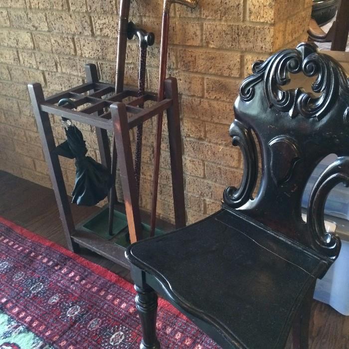 Antique umbrella/cane holder; one of several unique antique chairs
