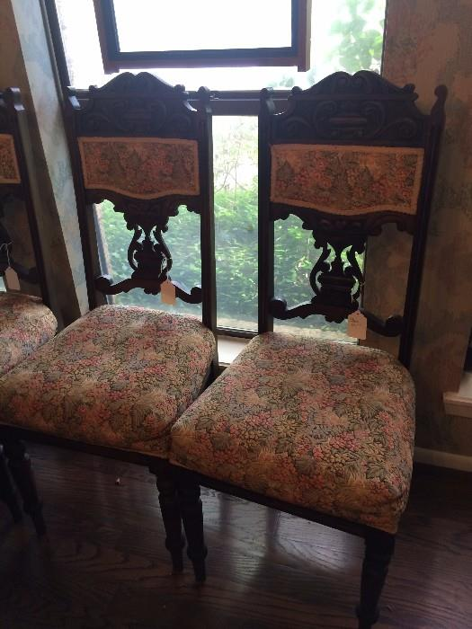 Two of four antique chairs
