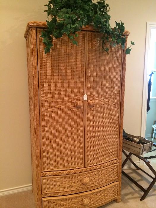 Wicker clothing armoire with storage below