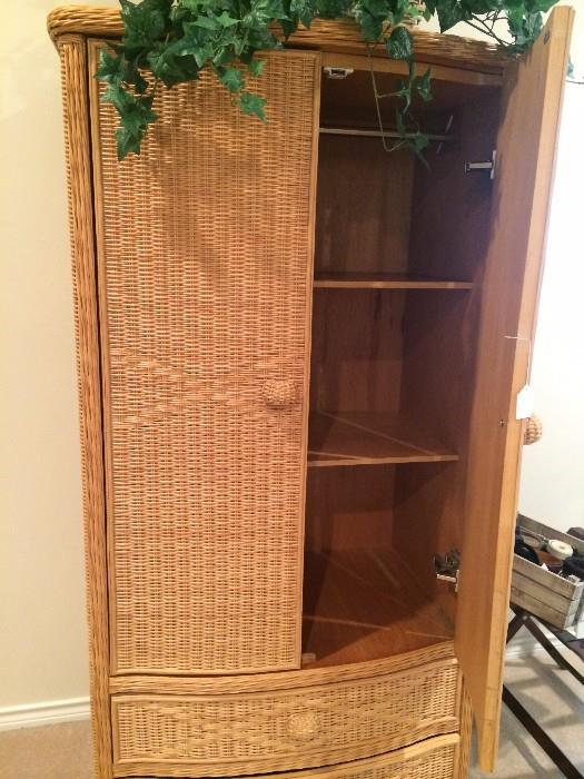 Wicker clothing armoire complete with rod, shelves, and drawers