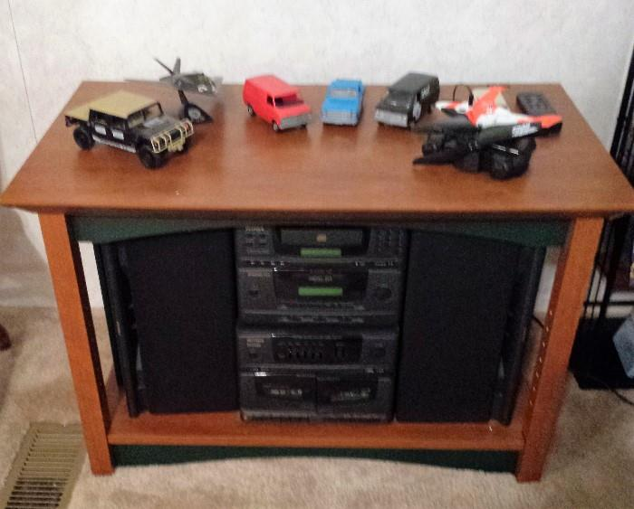 tv stand, stereo, model cars