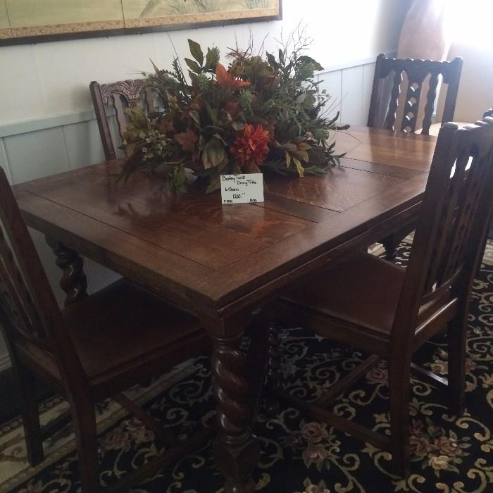 Exceptional barley twist antique table with 6 matching chairs