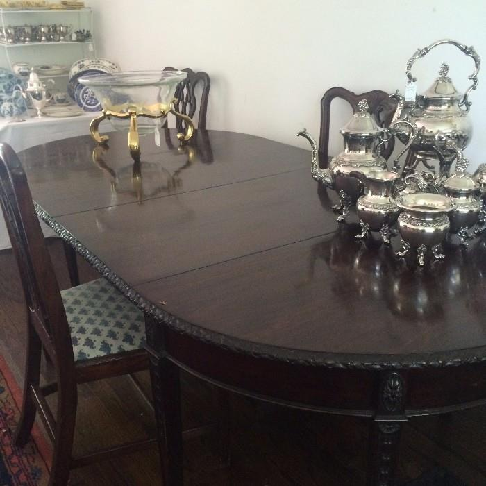Another antique dining table (can be made into two demilune tables); a 2nd silver plate tea service