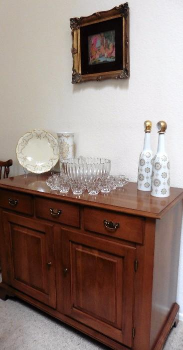 Framed weaving from Greece-Atemis & Actaeon. Hutschenreuther vase, decanters, Benck maple buffet.