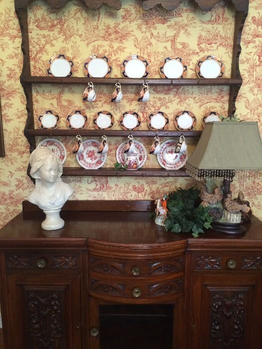 Intricately carved antique server with great storage;  antique plate rack