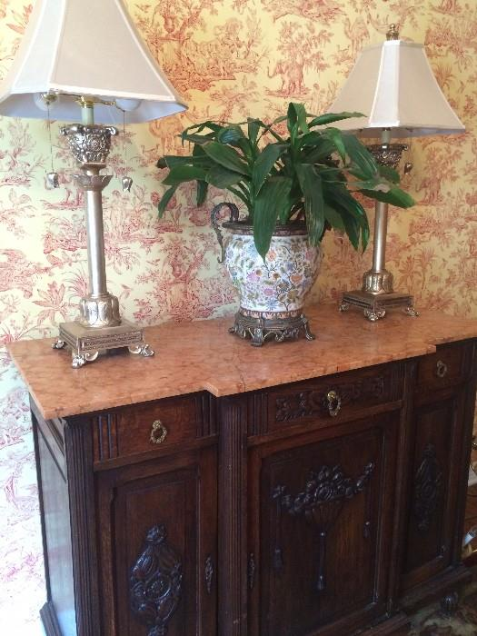 Gorgeous antique server/buffet with detailed carving and marble top; ornate planter and 2 identical lamps