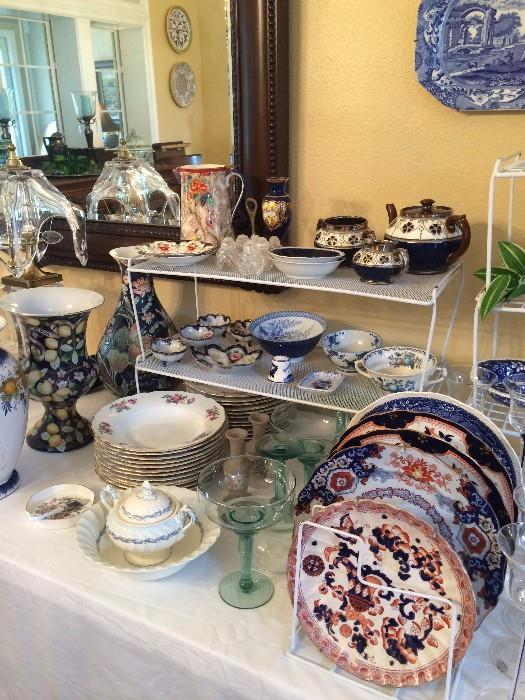Variety of vases, dishes, and decorative plates
