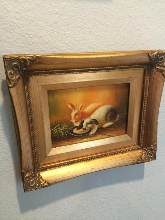 Framed oil of two rabbits