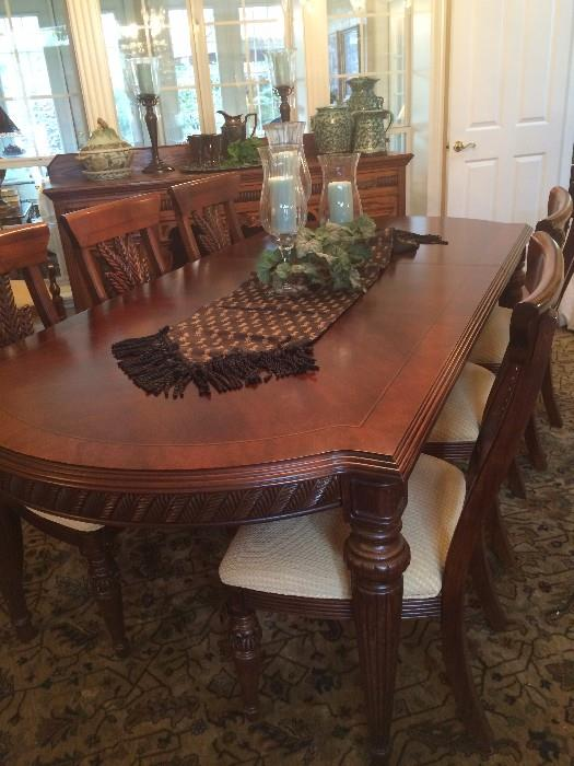 This elegant dining table has a total of 8 chairs.