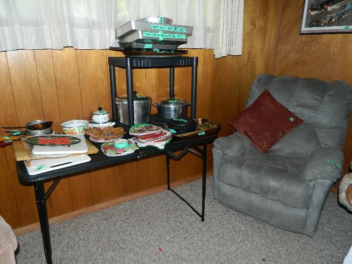 La-Z-Boy recliner - some of the kitchen items including Wilton Cake pans.