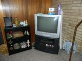 TV, TV stand, miscellaneous collectibles, 1 of several elephants