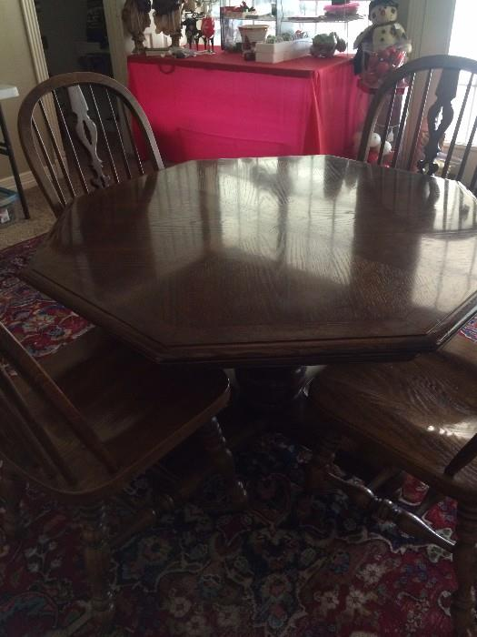 Octagon shaped game table with 4 chairs
