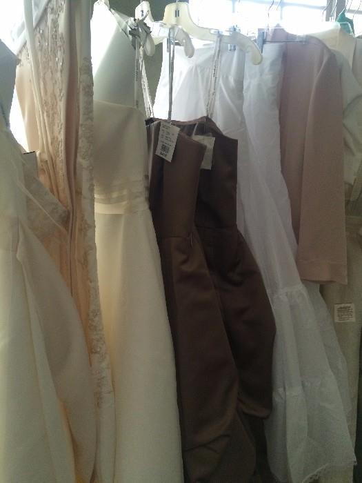 Several consigned wedding dresses an bridesmaid dresses