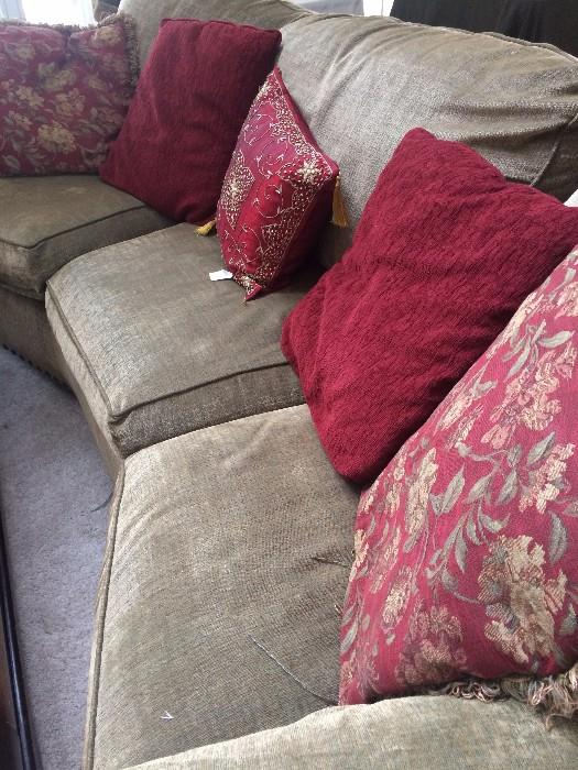 Curved sofa and decorative pillows