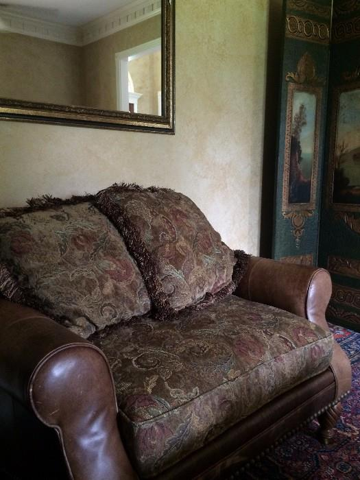 The over-sized chair matches the ottoman and sofa.