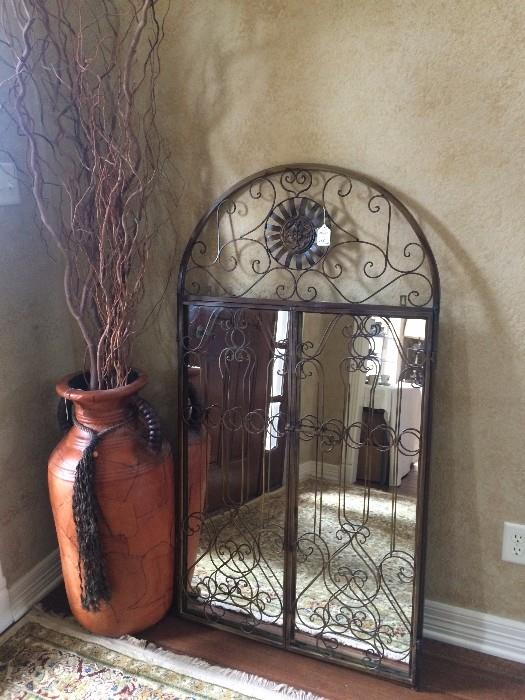 Large decorative urn and mirror