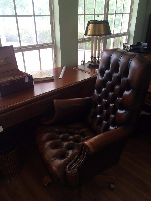 One of several desks; leather office chair