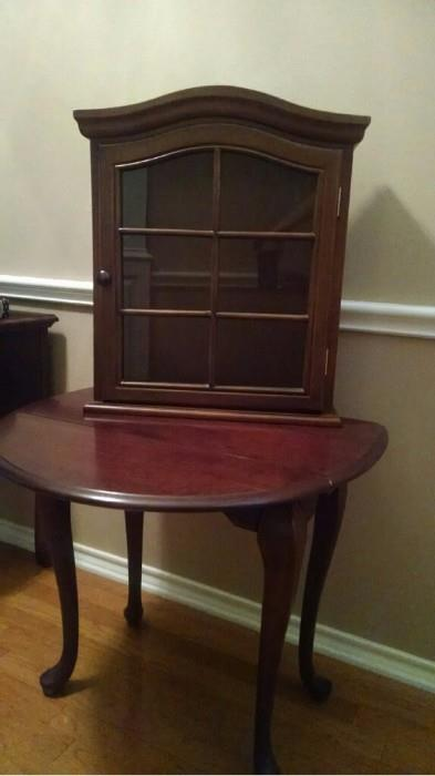 Small Queen Anne drop leaf table; curio cabinet