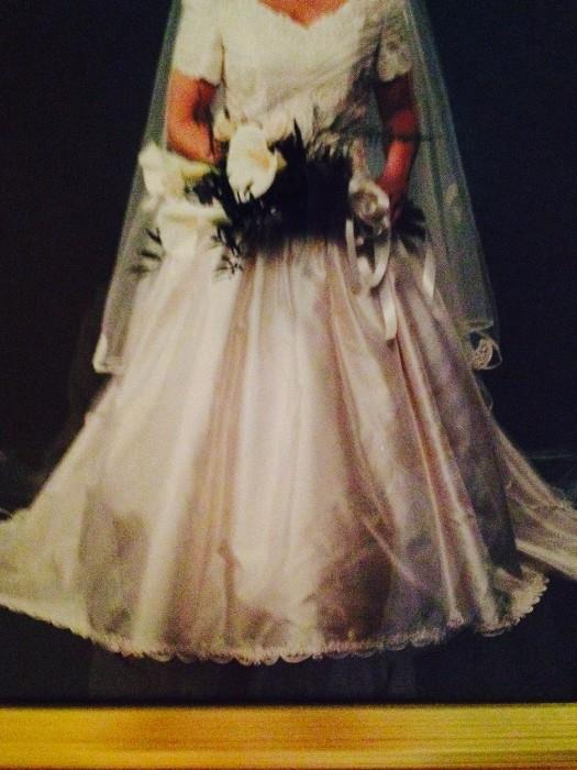 One of several consigned wedding dresses (designer Christos - Neiman Marcus); veil not included