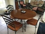 Ethan Allen iron and wood kitchen set with middle extension.