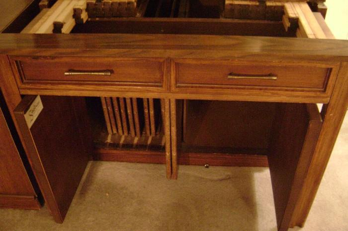 FOLD-OUT DINING-ROOM TABLE THAT LOOKS LIKE A CABINET WHEN CLOSED-UP---LOTS OF LEAVES FOR ENTERTAINING--JUST KEEPS GO'IN